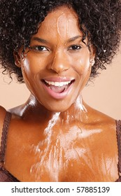 Cute African American with water dripping through her face