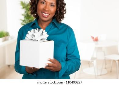 Cute African American woman with dark brown hair wearing a blue shirt.