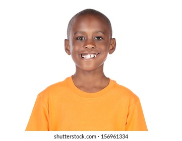Cute african boy wearing a bright orange t-shirt. The boy is standing and smiling at the camera.