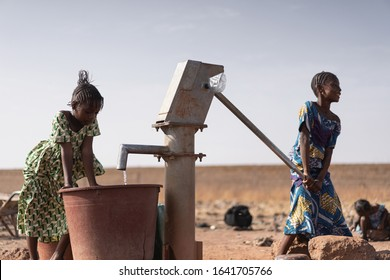 Cute African Ethnicity Infant Gathering healthful Water in a rural village