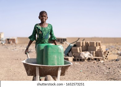 Cute African Girl Carrying Fresh Water in Bamako