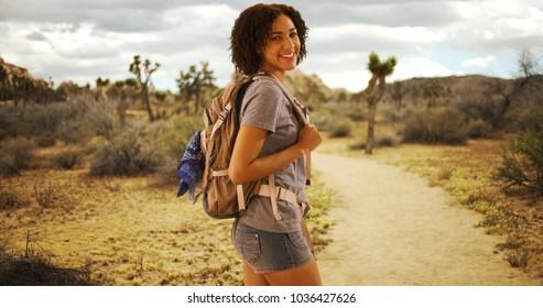 Cute African woman hiking Joshua Tree National Park