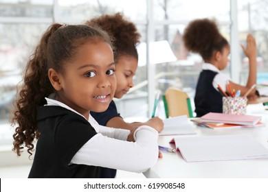 Cute African-American girls in classroom