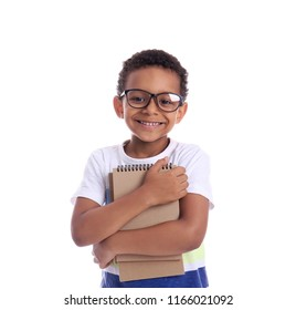 Cute African-American schoolboy with notebooks on white background