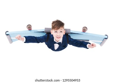 Cute ambitious little kid in suit flying with jet pack wings isolated on white background, Big dreams and success concept