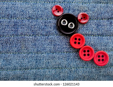 Cute Animal Made of buttons on a jeans texture background