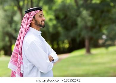 cute arabian man with arms crossed looking away