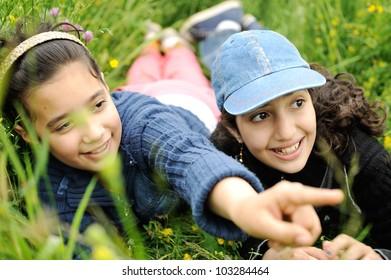 cute arabic  little girls smiling in a park close-up