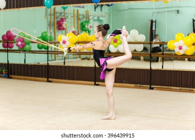 Cute art gymnast dancing with jumping rope
