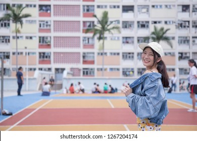 Cute Asia Girl smile to camera with Colorful rainbow design View of Choi Hung Estate. Located in Wong Tai Sin district of Kowloon, Hong Kong.