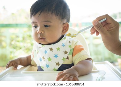 Cute asian baby bored with food