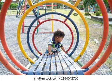 Cute asian baby boy play at playground