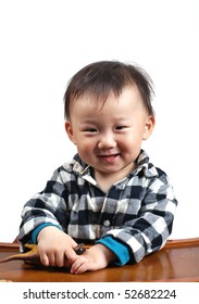 Cute asian baby boy smiles,  isolated in white background