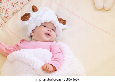 Cute asian Baby in baby cocoon or sleeping  bag, baby sleeping in Baby crib,vintage and soft picture style