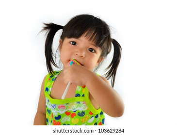 cute asian baby girl and big lollipop of thailand southeast asia