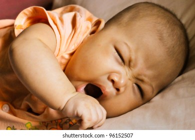 Cute asian baby with her yawn