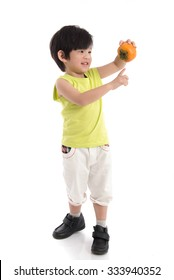Cute asian boy holding persimmon on white background isolated