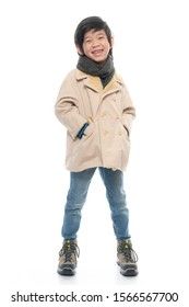 Cute Asian boy in warm clothing  on white background.isolated