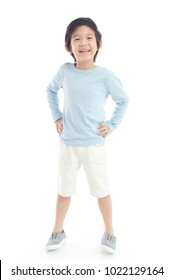 Cute Asian child  in blue t-shirt  standing on white background isolated