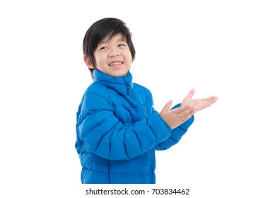 Cute Asian child in blue winter clothes open palm hands on white background isolated