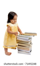 Cute asian child girl looking at books .