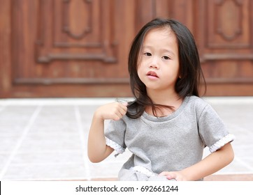 Cute asian child girl outdoor. Portrait beautiful girl.