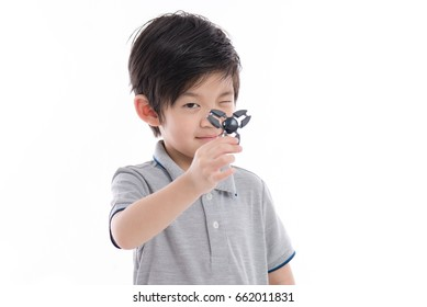Cute Asian child  holding  fidget spinner on white background isolated