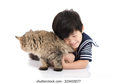 Cute asian child lying with tabby cat on white background isolated