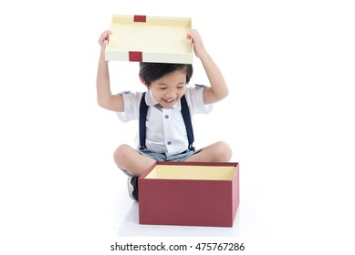 Cute Asian child opening gift present box on white background isolated