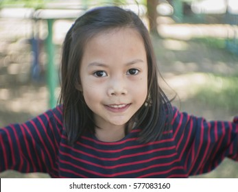 Cute Asian child playing in a park.