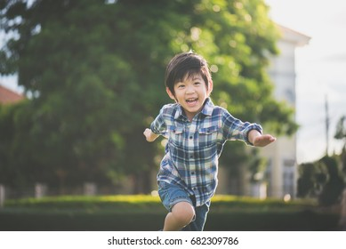 Cute Asian child playing in the park
