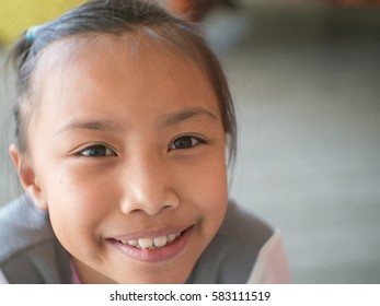 Cute Asian child smiling.