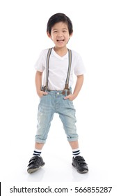 Cute Asian child  in white t-shirt and jeans standing on white background isolated