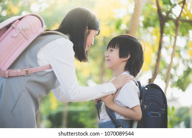 Cute Asian children    going to the school outdoors,back to school concept