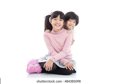 Cute asian children sitting on white background isolated