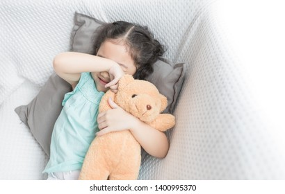 cute asian children stretching on white sofa, she sleepy and lazy in the morning, child health promotion