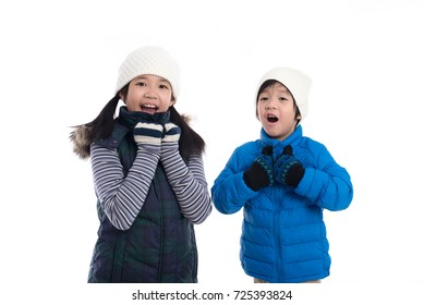 Cute Asian children in winter clothes is surprise and so happy about it on white background isolated