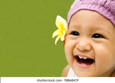cute asian ethnic toddler girl laughing