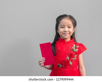 bbb68d43c Cute Asian girl in chinese cheongsam and Tradition Chinese dress with red  envelope , Chinese new