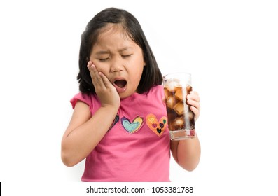 cute asian girl drink feeling teeth painful and found having sensitive tooth problem look at white background