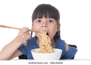 Cute asian girl eating noodle on white background isolated