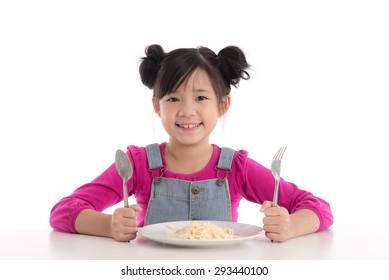 Cute asian girl eating Spaghetti Carbonara on white background isolated