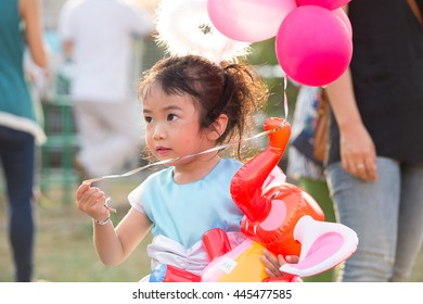 Cute asian girl with fancy costume at school event