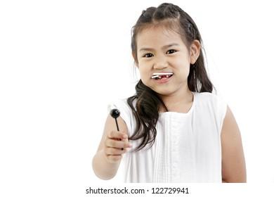cute asian girl and lollipop