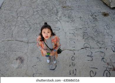 Cute Asian girl on the seaside