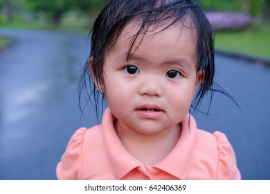Cute asian girl playing in the garden, close-up portrait, Portrait of Asian beautiful baby girl of 1 year and 3 months old.