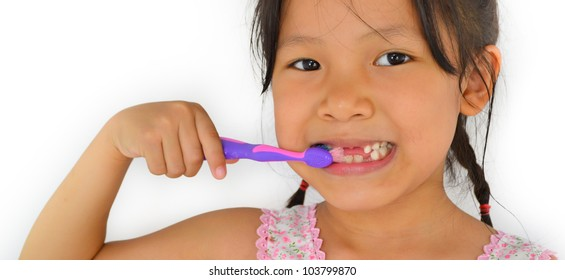 cute asian girl and toothbrush of thailand southeast asia