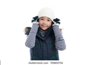 Cute Asian girl in winter clothes on white background isolated