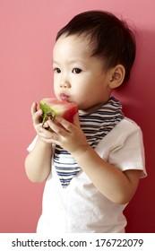 Cute Asian girl,eating watermelon