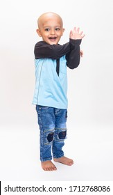 Cute Asian Little Boy standing Isolated on the grey Background